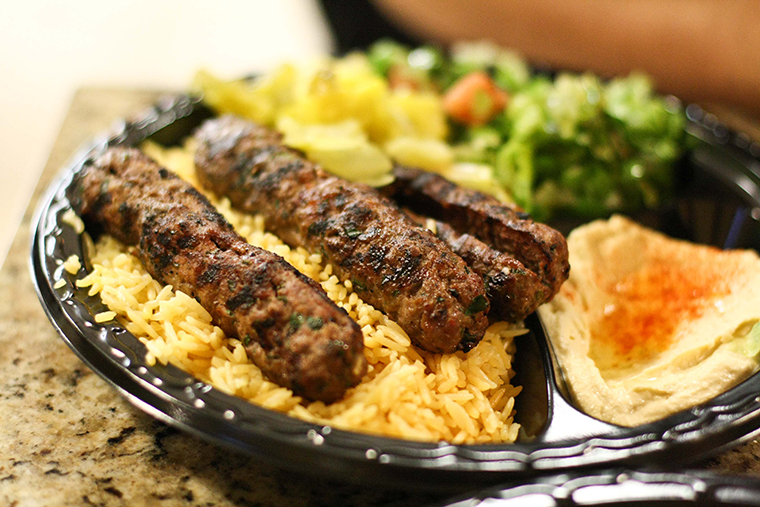 Ground beef infused with spices served with rice, tabouli and hummus along with two hot loaves of pita bread.